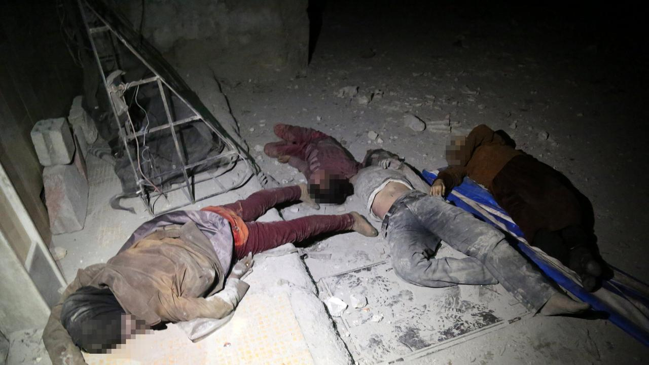 Local media reports suggest up to 70 people died after a helicopter dropped a barrel bomb allegedly containing Sarin gas, a nerve toxin that kills within minutes of direct inhalation unless treated quickly with an antidote. Picture: AAP