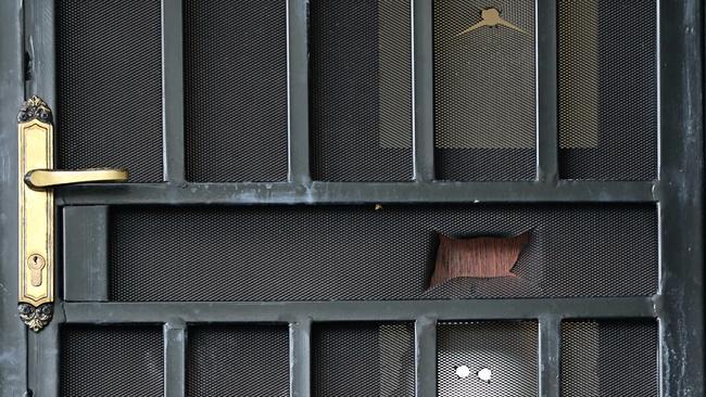 A bullet hole in the door's flyscreen. Picture: John Grainger