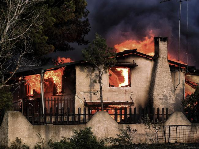 A burned house is seen in Agios Andreas, east of Athens. Picture: AFP/Valerie Gache