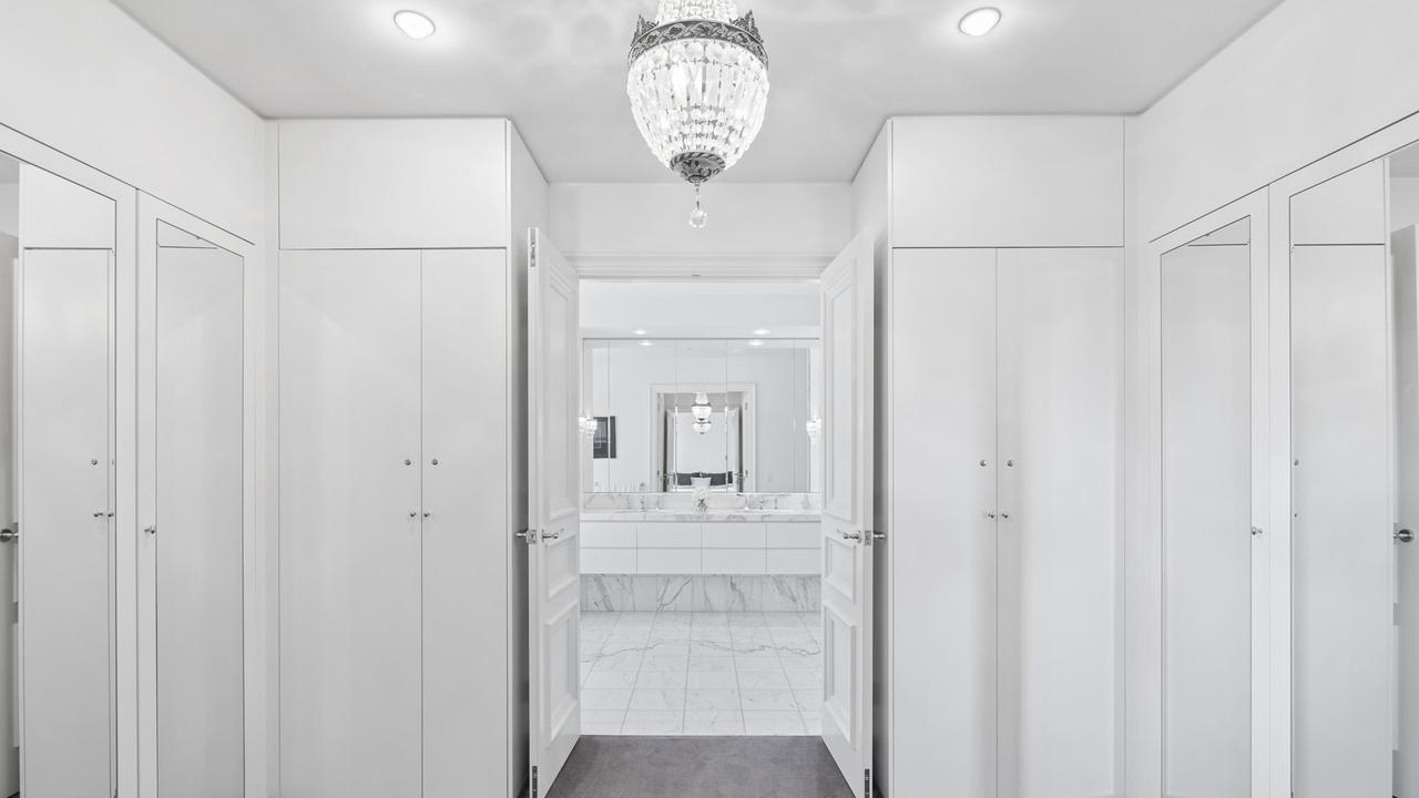 A luxurious walk-in robe opens into the bathroom.