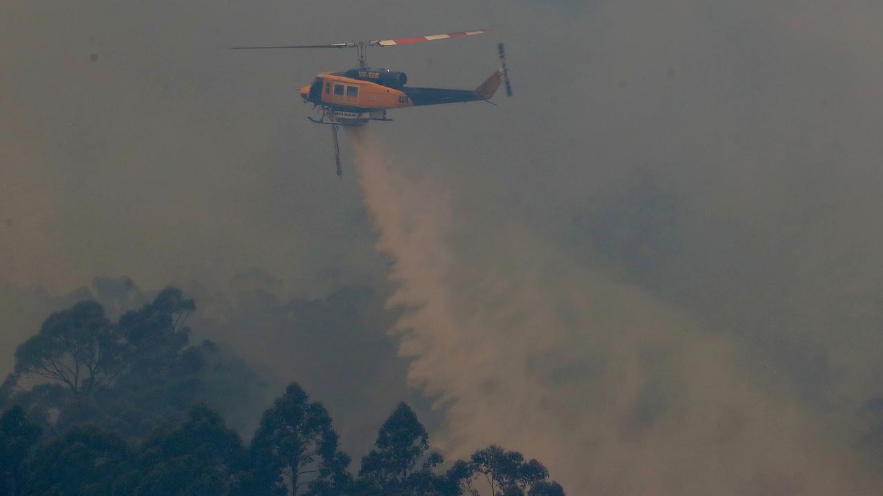 A waterbombing helicopter seen from Rileys Creek Rd, Geeveston. Picture: NIKKI DAVIS-JONES