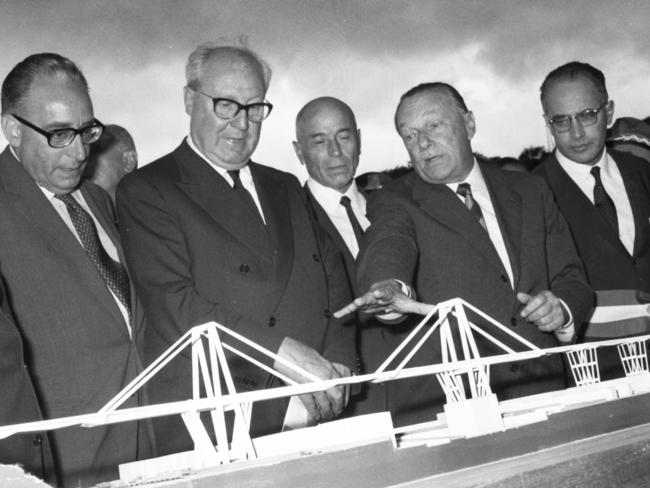 Photo from 1967 shows engineer Riccardo Morandi (second from right) looking at a model during the inauguration of the Morandi motorway bridge in Genoa. Picture: AFP