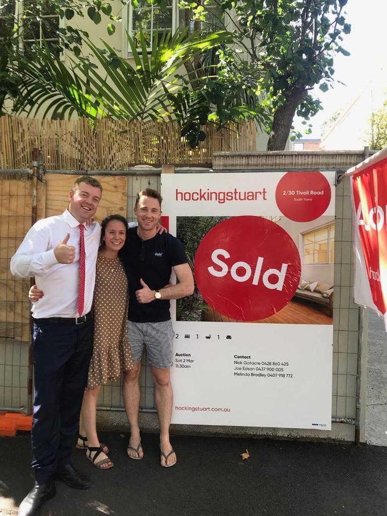 Agent Nick Gatacre celebrates the sale with vendors Victoria and Jarrod Voss.