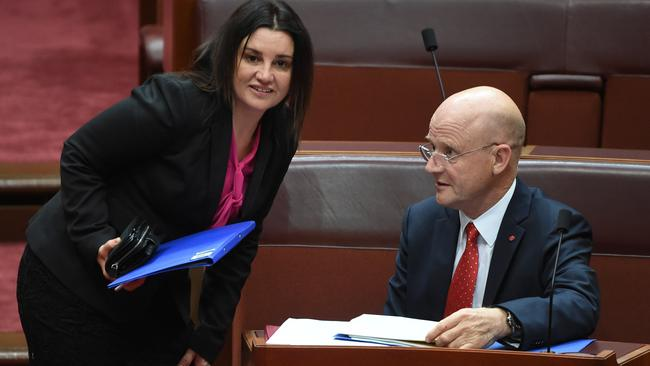 Tasmanian Senator Jacqui Lambie and Liberal Democratic Party David Leyonhjelm after the vote for the Same Sex Marriage Plebiscite Bill in the Senate. Picture: Mick Tsikas / AAP