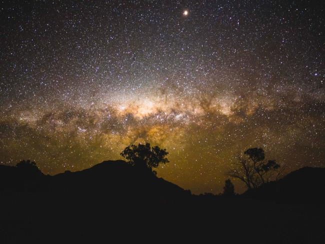 It boasts some of the most spectacular sights visible from earth including the bright centre of our own galaxy, the Milky Way. Warrumbungle is an aboriginal word from the Kamilaroi people and it means 'crooked mountains'. The name is apt for the iconic jagged landscape that hems the wide dome of starry skies in the world-heritage listed Warrumbungle National Park. Picture: Destination NSW