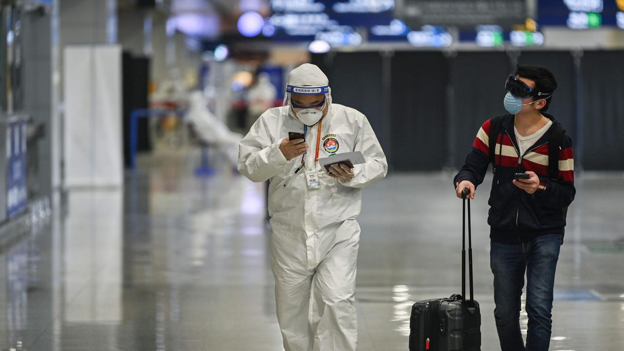 A member of the airport security, wearing protective gear as a preventive measure against the COVID-19 coronavirus outbreak. Picture: Hector Retamal/AFP