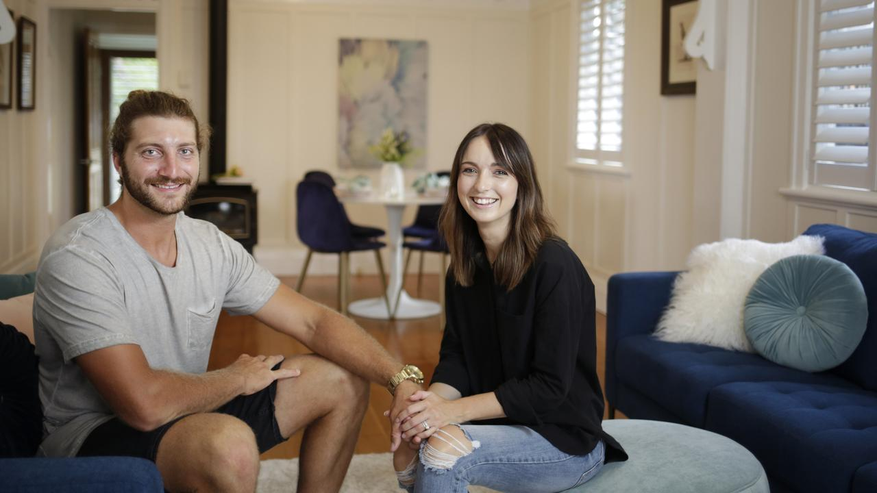 Lizzy and Gerard Tibbetts are looking to buy in Sandgate. Photo: AAP/Megan Slade.