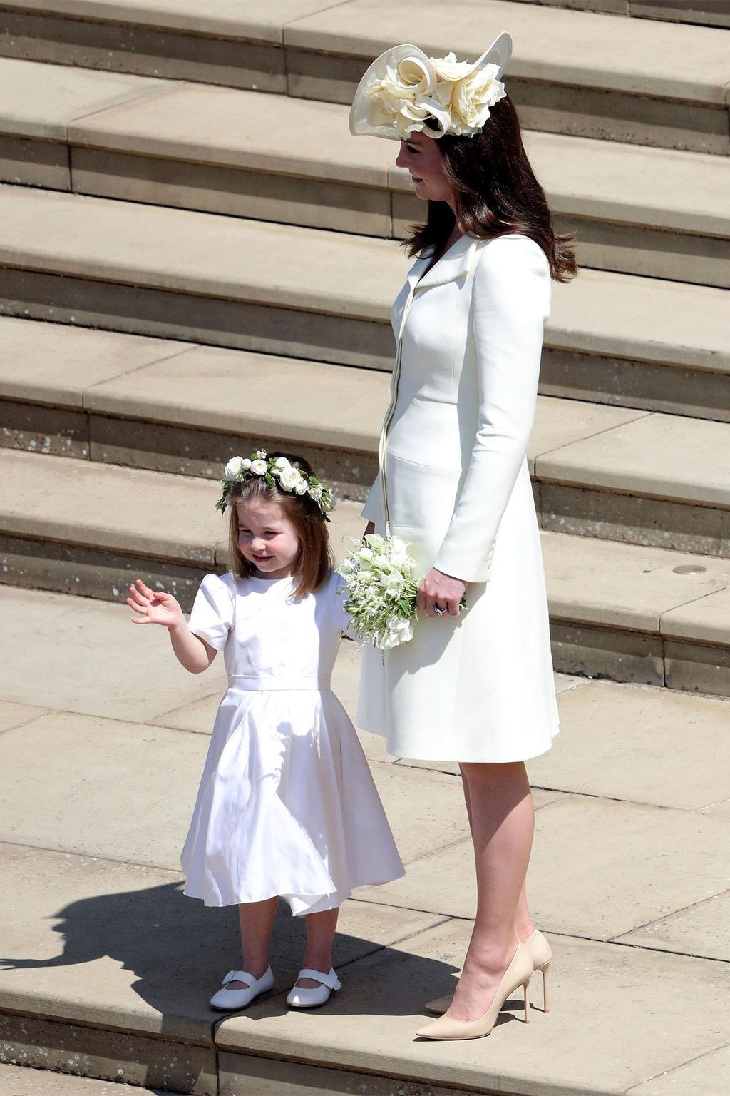 Kate Middleton re wears her Alexander McQueen coat dress for
