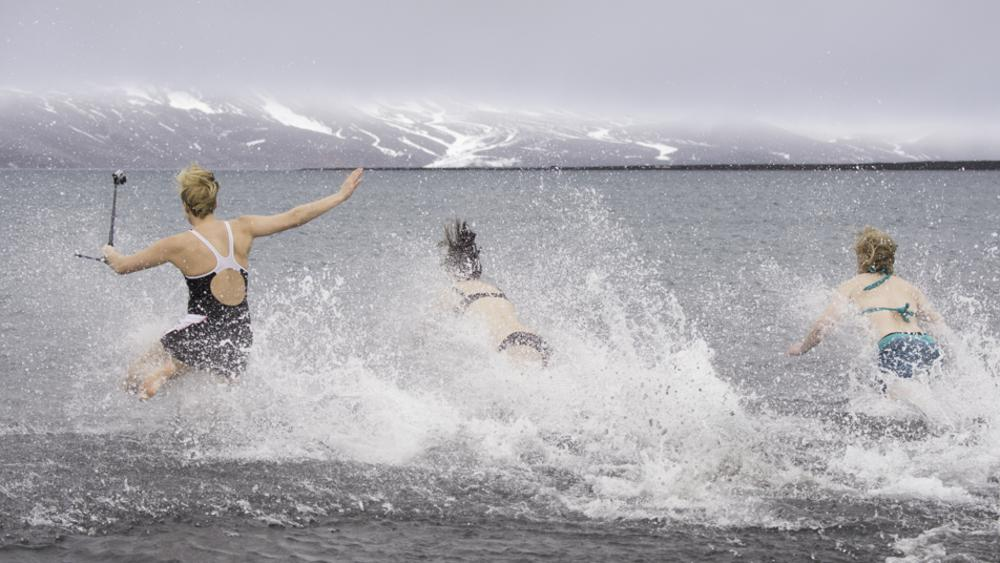 Supplied Travel POLAR PLUNGE for story by Angela Saurine. Akademik Ioffe passengers taking the polar plunge at Whal