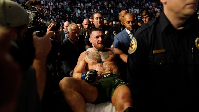 Conor McGregor was carried off on a stretcher after losing to Dustin Poirier in a UFC 264. AP Photo/John Locher