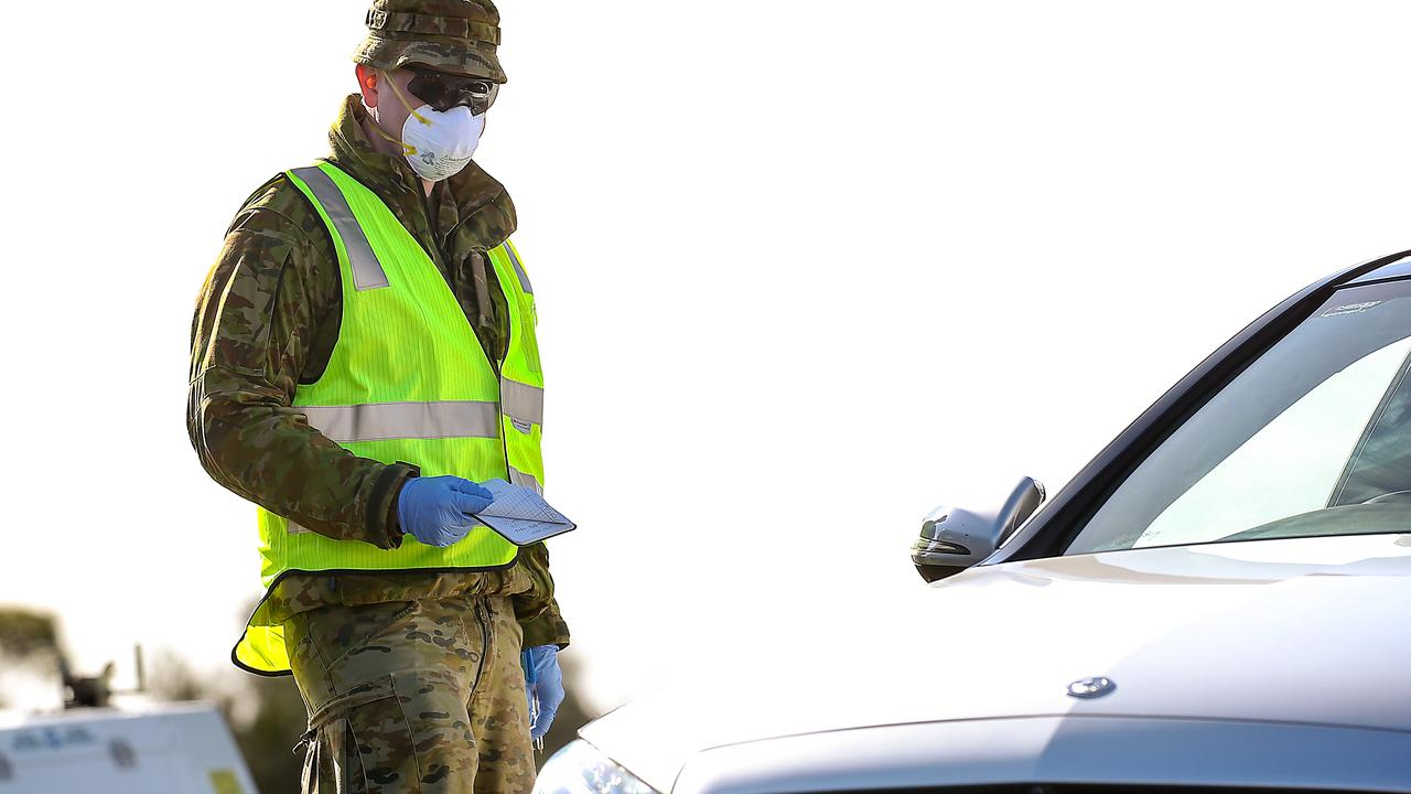 An Australian soldier assists police at a vehicle checkpoint on the Princes Hwy at Little River near Geelong. Picture: NCA NewsWire / Ian Currie