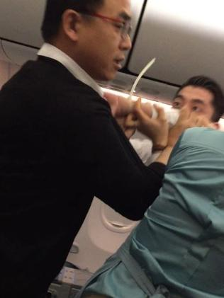 Other male passengers stepped in to help.