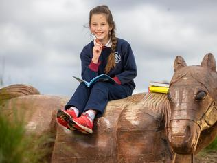 Grade 4 student Olivia Green, 9yo, pictured in Eureka Stockade Gardens, Ballarat East is preparing to enter the Kids News Short Story Competition again this year after scoring a Highly Commended for her story, Covid Cooking, last year. Picture: Jason Edwards