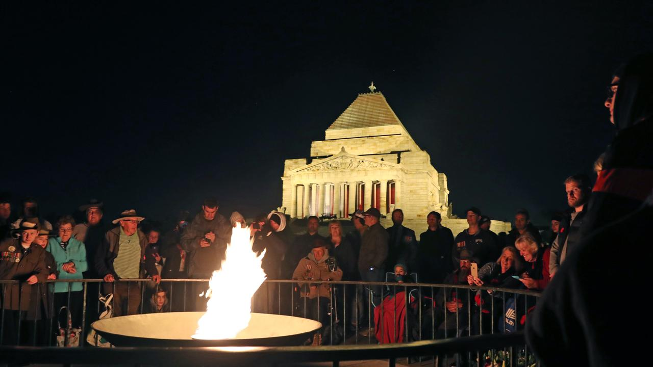 Crowds gather during the Anzac Day Dawn Service in front of the perpetual flame at the Shrine of Remembrance in Melbourne on April 25, 2019. Picture: AAP Image/David Crosling
