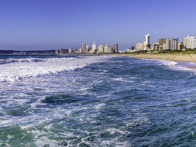 """DURBAN'S GOLDEN MILE The main reason that most locals (and surfers) visit Durban is because of its spectacular beaches. The warm waters of the Indian Ocean make this a busy place in the warmer months, so book ahead. Even if you have no intention of catching a wave, the promenade of Durban's """"Golden Mile"""" stretch of beach is a great place for a stroll or, if it's too hot to walk, hire a rickshaw ride and watch the world go by."""