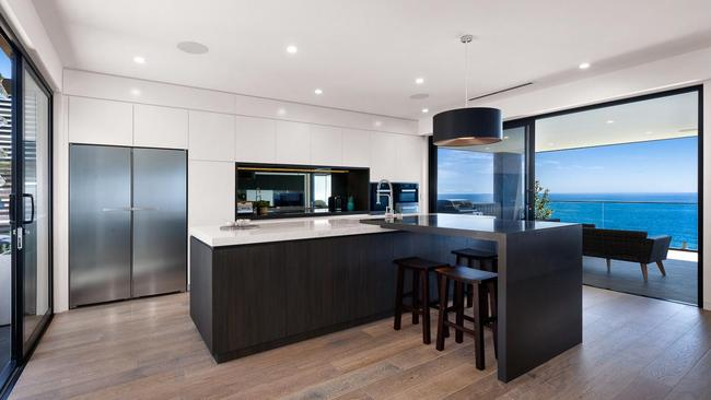 The open kitchen area is connected to both front and back decks.