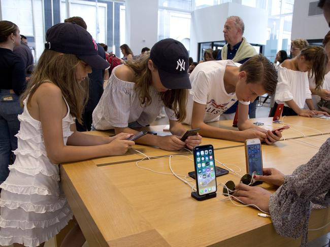 Customers browse in an Apple store in New York last month. Picture: Mark Lennihan