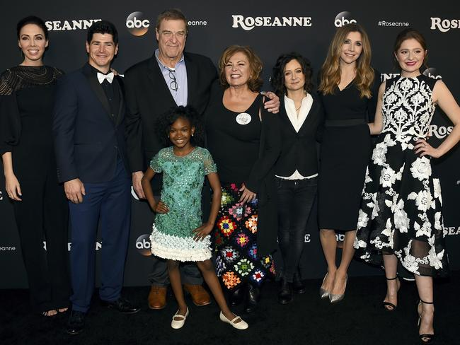 The cast of the Roseanne reboot and co-showrunner, Whitney Cummings, left. Picture: AP