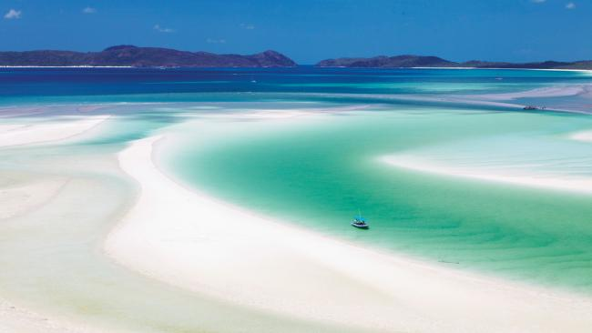 Whitehaven Beach, Queensland In the Whitsundays lies one of Australia's most jaw-dropping beaches. Take a boat to get here, either by yourself bare boating (here's how to do it) or with a day cruise. You can even take a helicopter here, with the amazing side benefit of seeing the Whitsundays from air. Picture: Maxime Coquard/Tourism Australia
