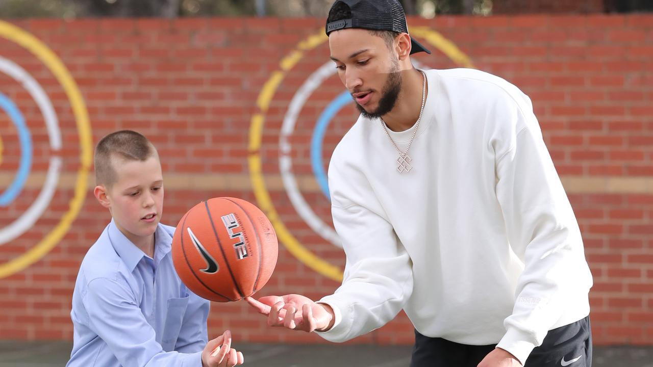 Ben Simmons surprised Charlie Sweet, 12, in his classroom for the Make-A-Wish Foundation. Charlie has been diagnosed with a rare type of cancer and was granted his wish to meet and play one-on-one with his basketball idol at Carey Baptist Grammar School in Kew. Picture: Alex Coppel