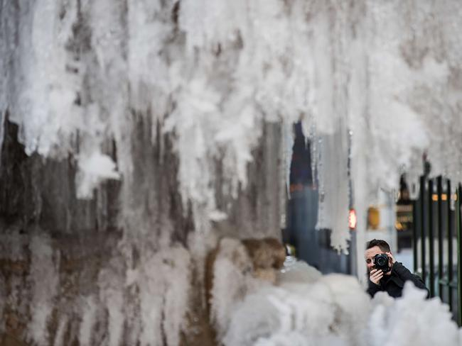 A fountain in New York's Bryant Park was frozen solid. Picture: Drew Angerer/Getty Images/AFP