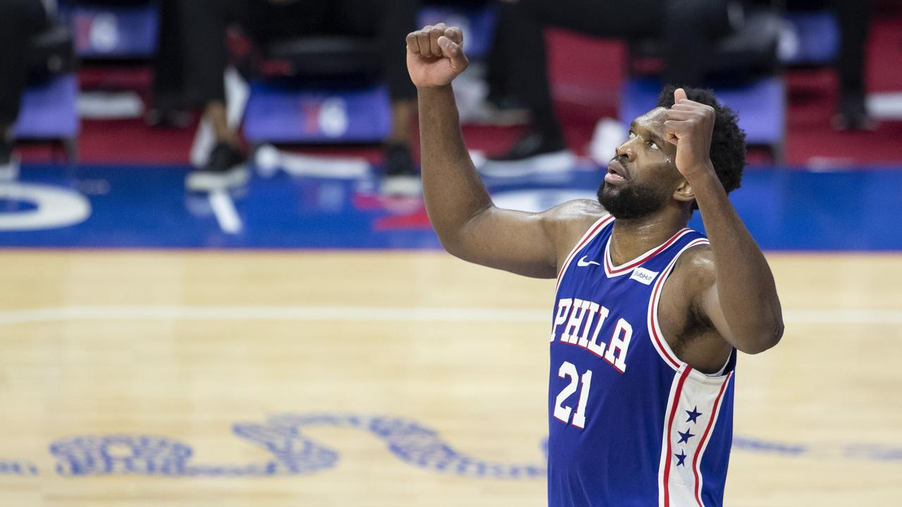 Joel Embiid celebrates after scoring 50 points in the 76ers win over the Bulls.