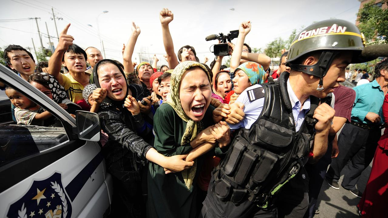 Uighur women during a protest in Urumqi in 2009. Picture: Peter Parks/AFP