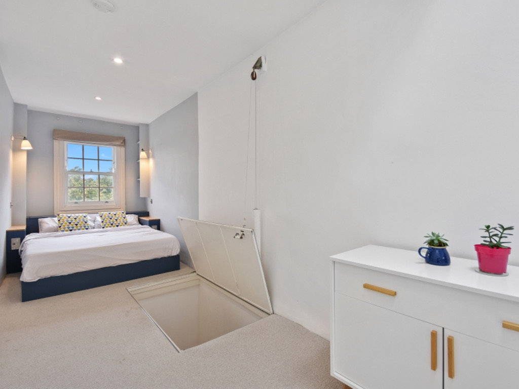The main bedroom has a built-in bed.