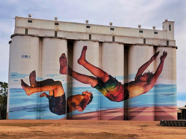 2. AUSTRALIAN SILO ART TRAIL   Since the West Australian wheatbelt town of Northam, 100km east of Perth, unveiled giant murals painted on its grain silos in 2015, a public art phenomenon has taken hold throughout regional Australia. Once stagnating dots on the map in Queensland, NSW, Victoria and South Australia have been re-energised with portraits of local life immortalised by internationally renowned street artists. South Australia joined the trail in 2017 when Brisbane artist Guido van Helten sprayed 30m-high silos in tiny Coonalpyn, on the Dukes Highway between Adelaide and Melbourne, with paintings of five schoolchildren. Picture: Annette Green