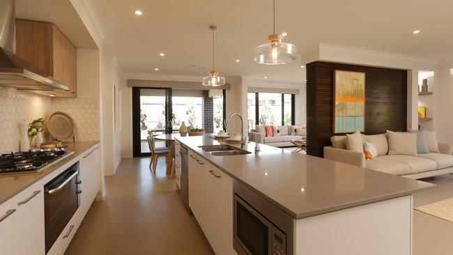 The kitchen and living spaces are open-plan.