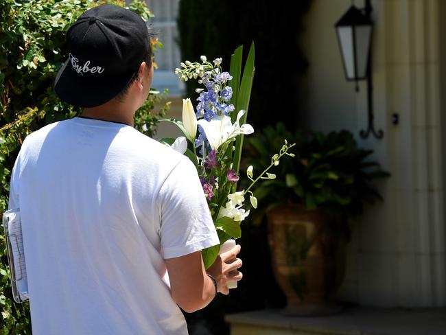 A courier delivers flowers to the Hird family home on Friday. Picture: Nicole Garmston