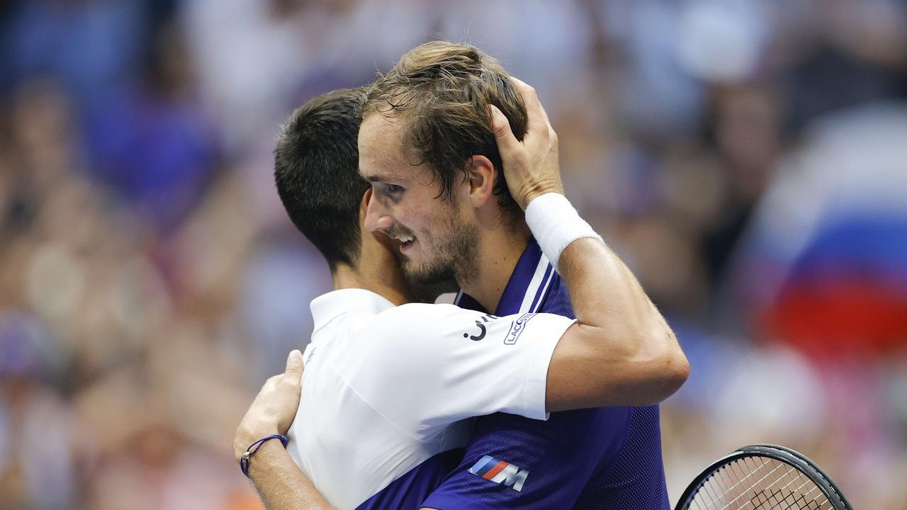 Daniil Medvedev and Novak Djokovic embrace at the net. Photo: Sarah Stier/Getty Images/AFP.