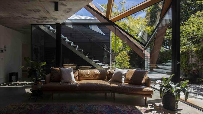 Light streams into the house through the leaf-like extension. Picture: Armelle Habib