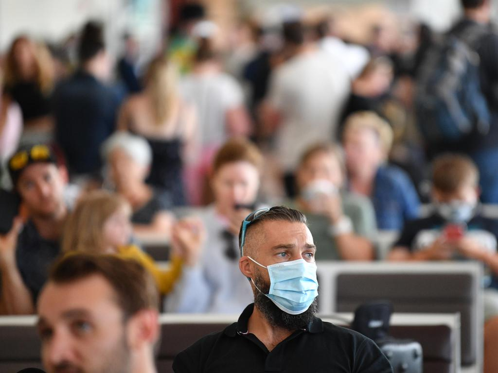 Hundreds of people were seen waiting for flights at Adelaide Airport after new border restrictions came into place. Picture: NCA NewsWire/David Mariuz