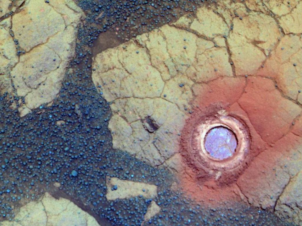 This hole was actually created by Opportunity, using its rock abrasion tool. The rock in question was nicknamed 'Gagarin', and measures 4.5cm across. Picture: NASA