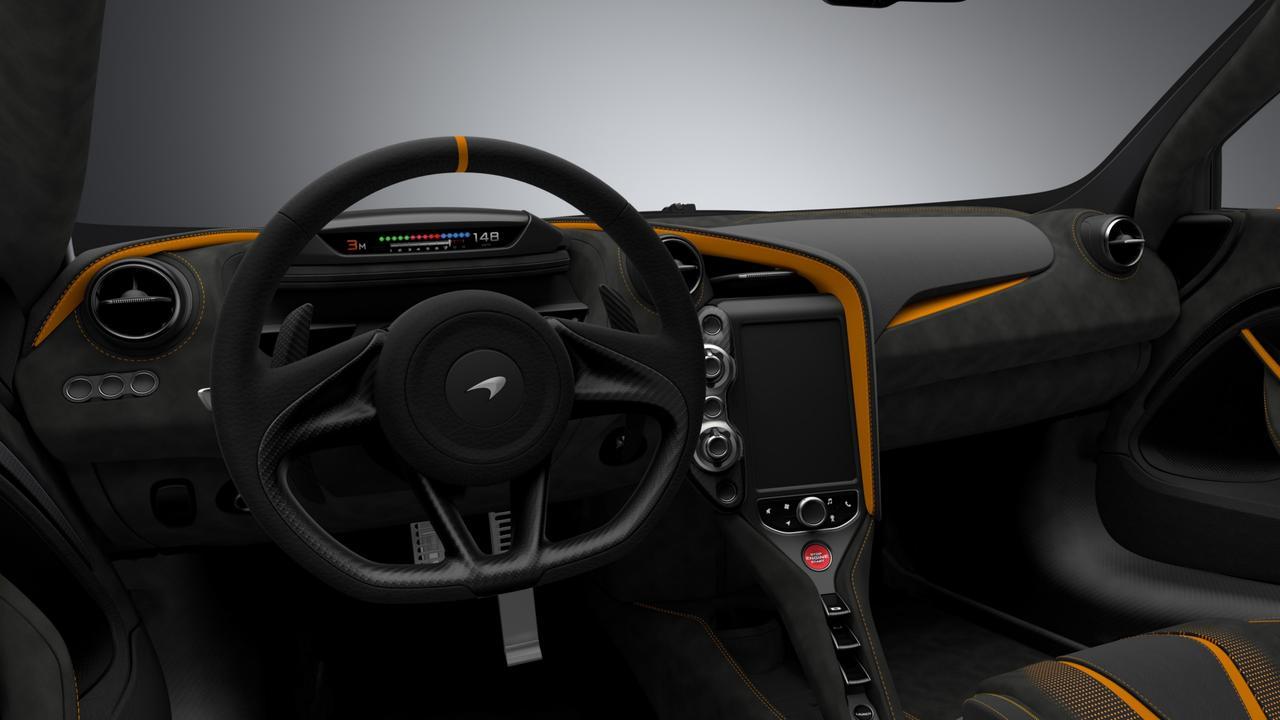 The car's cabin has carbon fibre, Alcantara and a clever folding digital dashboard.