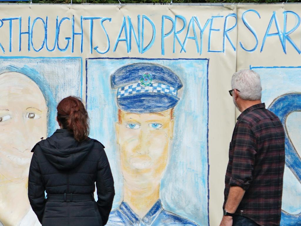 A mural dedicated to four Victorian police officers at St Mary's Primary School in Melbourne. Picture: Scott Barbour/AAP