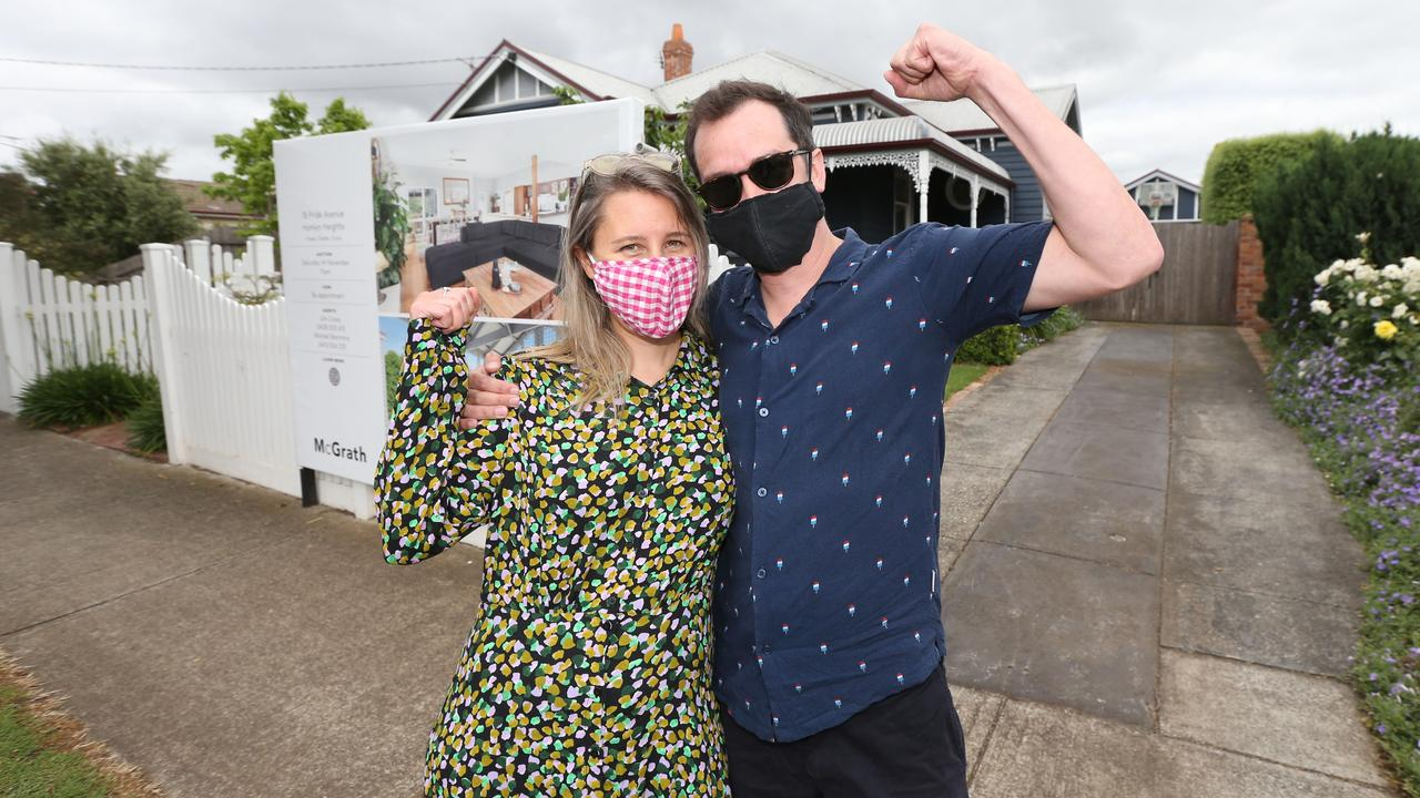 Melbourne couple Elise Baro and Barney Wilson were the highest bidders for this Hamlyn Heights character home. Picture: Mike Dugdale