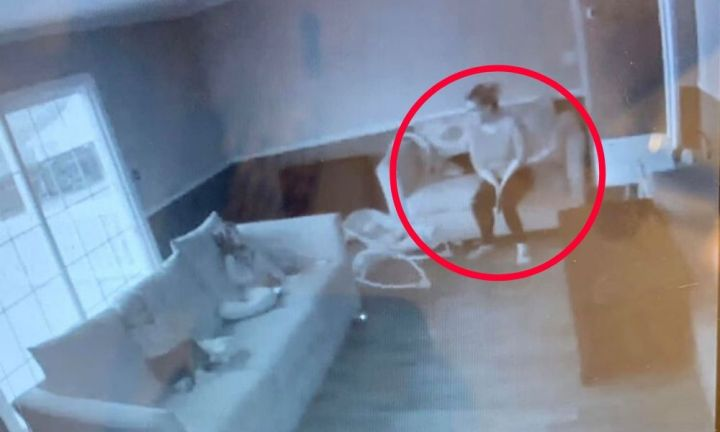 Mum spots 'ghost' with kids in security camera