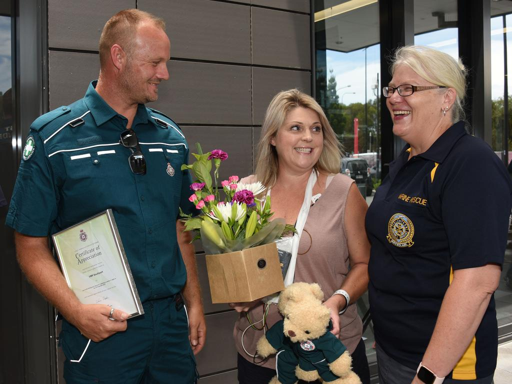 Natalie Fullagar reunites with QAS first responder Adam Watson and Katy Counsell from Southport Volunteer Marine Rescue. Picture: NCA NewsWire / Steve Holland