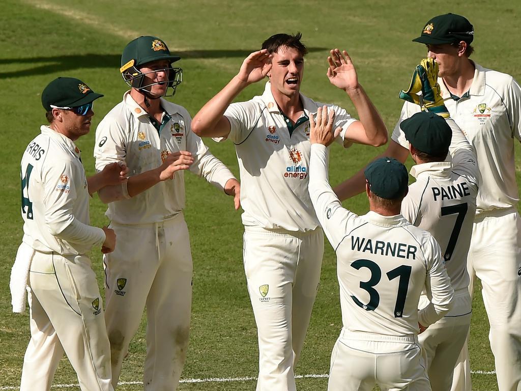 Pat Cummins of Australia celebrates taking the wicket of Cheteshwar Pujara.