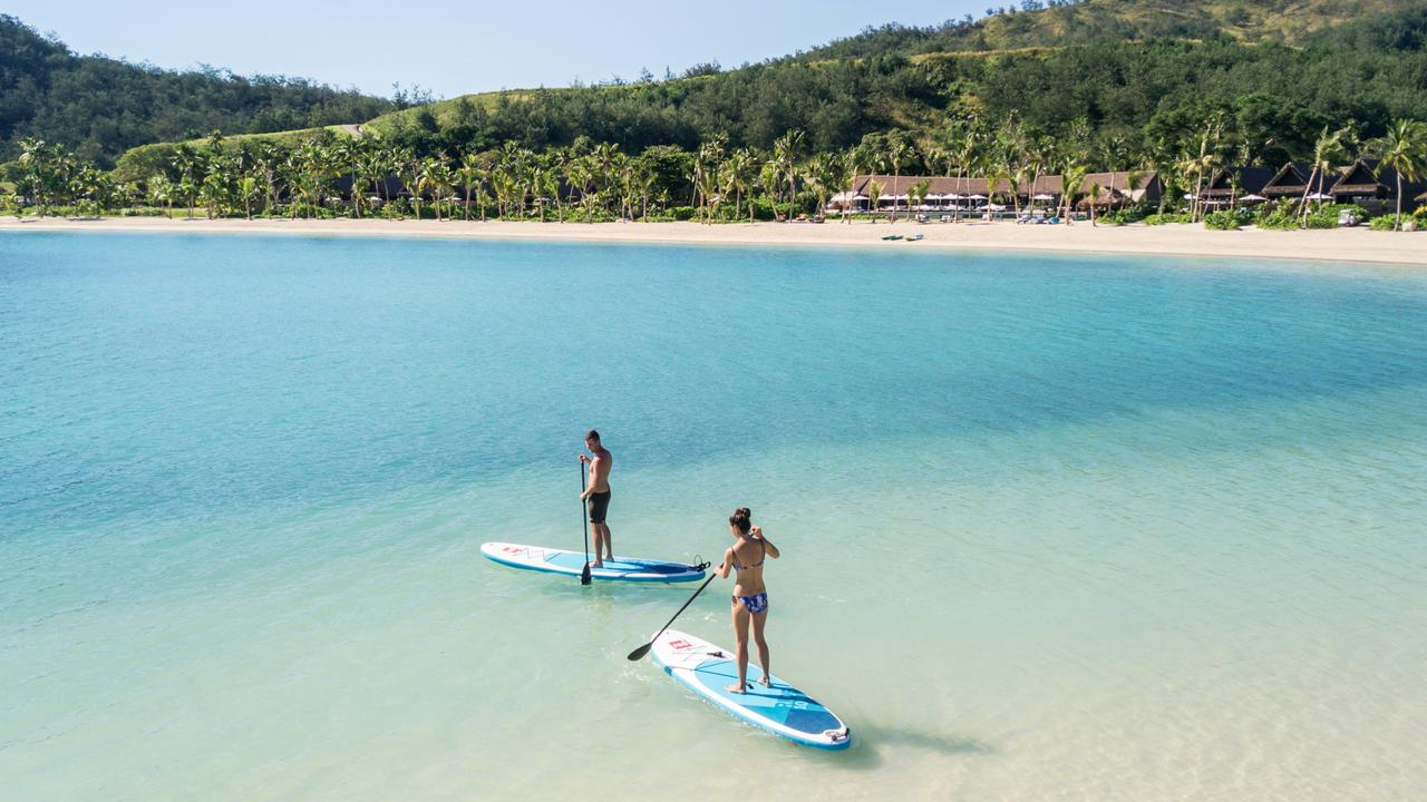 Paddleboards in a lagoon offer yet another way to soak up Fiji's sublime seascapes. Picture: Amber Toms/Six Senses