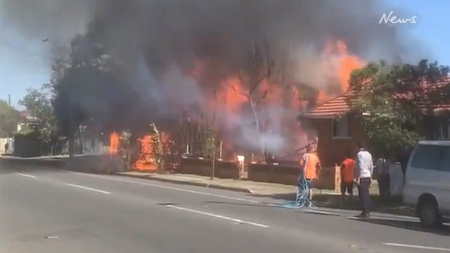 Fire rips through homes in Brisbane