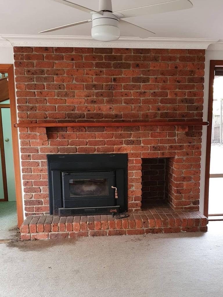 Ms Kumnick-Diaz says the brick fireplace was one of the features that drew them to the home, however they wanted to refresh the colour scheme. Picture: Supplied.