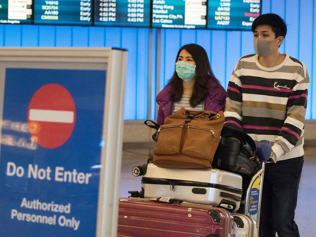 Passengers wear masks to protect against the spread of the virus at the Los Angeles International Airport, California. Picture: Mark Ralston/AFP