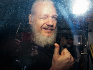 Julian Assange gave a thumbs up and a wink as he arrived at court. Source: Getty Images