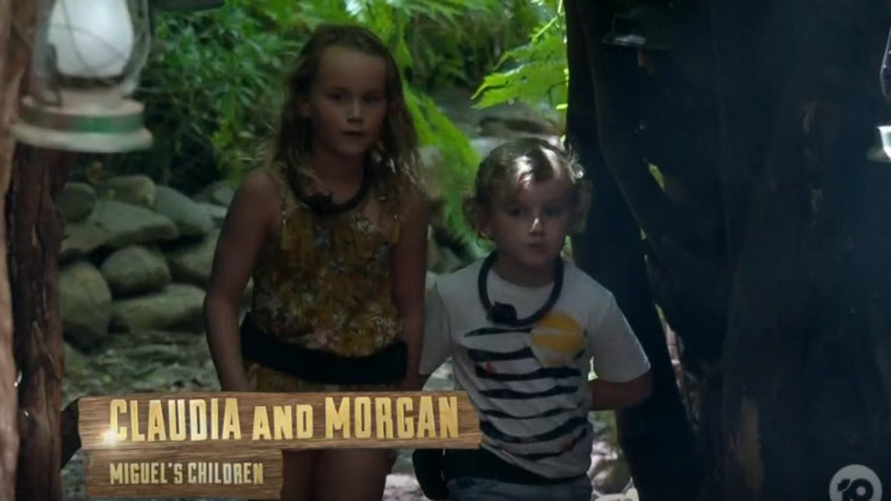 Miguel's two children sneak into camp.