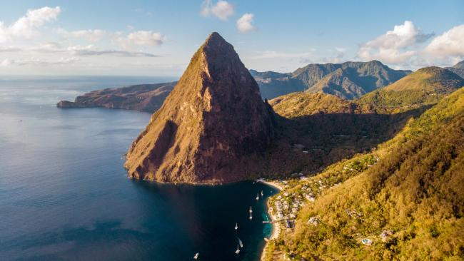 Whether you spend your time luxuriating in the warmth of its golden-sanded beaches or hiking up through the rainforest of Gros Piton, you'll be in for an unforgettable experience.