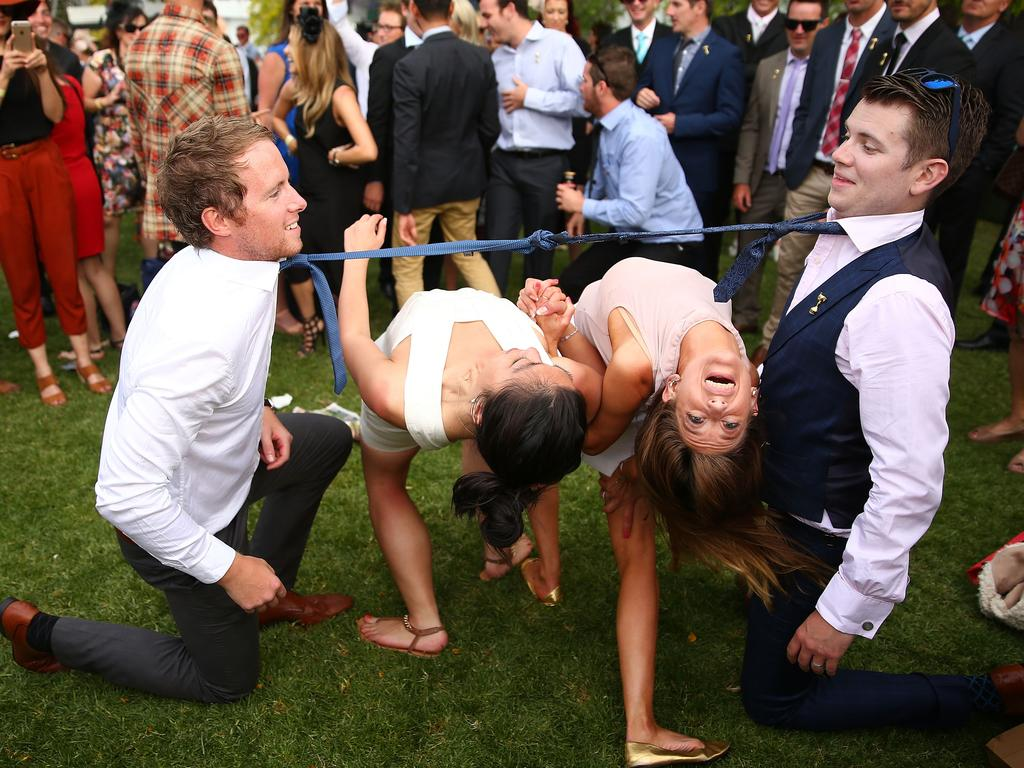 These punters have an impromptu game of limbo. Picture: Scott Barbour/Getty Images