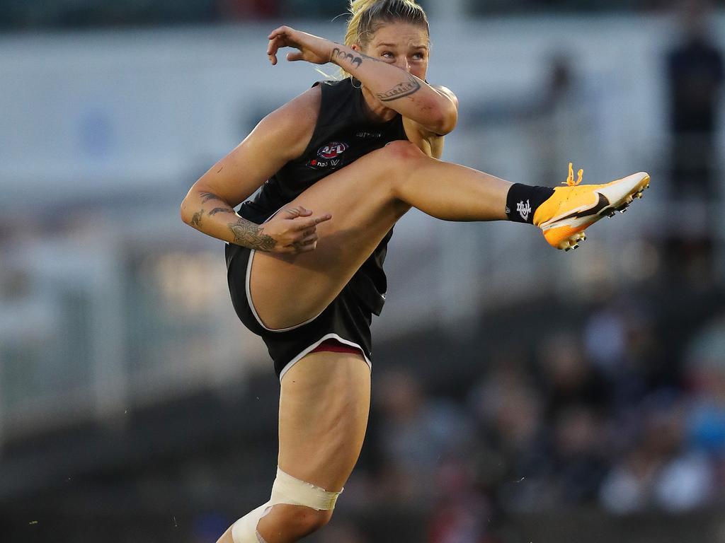 Carltons Tayla Harris kicks long at goal during the 3rd qtr. . Pic: Michael Klein